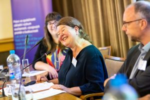 a woman smiling at the conference table
